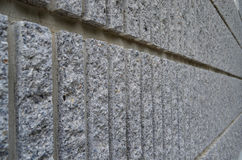 Side view of gray coarse cement wall background. Side view of gray coarse cement wall texture stock photo