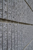 Side view of gray coarse cement wall background. Side view of gray coarse cement wall texture stock images