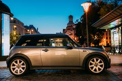 Side View Of Gray Color Mini Cooper Car Parking On Street In Eve Stock Image