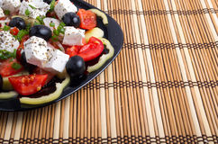 Side view of the Greek vegetarian salad of tomatoes, cucumbers, Stock Image