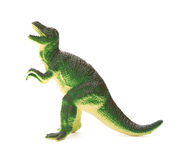 Side view green plastic dinosaur toy on white background Stock Images