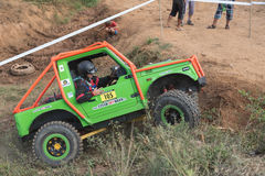 Side view of a green small off road car in terrain Stock Images