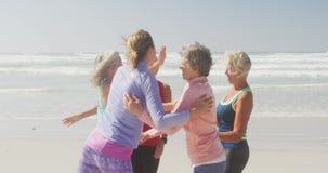 Athletic women having fun on the beach