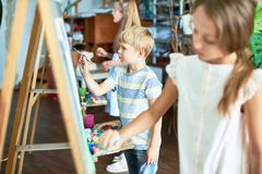 Little Artists Busy Painting stock photography