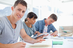 Side view of a group of students as one student looks at the cam Stock Photo