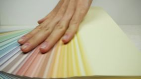 Side view of hand moving on the color palette and opening it. Slow motion.  stock video footage