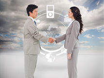 Side view of hand shaking trading partners Stock Image