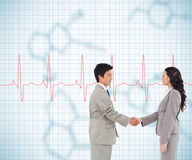 Side view of hand shaking trading partners Stock Photos
