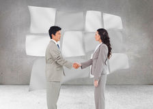 Side view of hand shaking trading partners Stock Photography