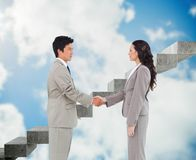 Side view of hand shaking trading partners Stock Photo