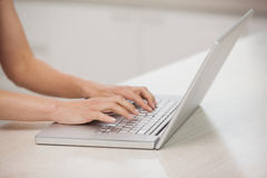 Side view of hands using laptop Stock Photos