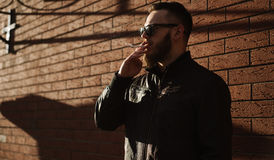 Side view of handsome bearded man smoking Royalty Free Stock Images