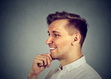 Side view of handsome happy man daydreaming Stock Images