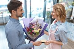 Florist and client with credit card Stock Image