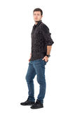 Side view of handsome male model in casual wear with hand in back pocket Stock Photos