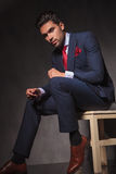Side view of a handsome young business man sitting Stock Images