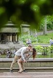 Romantic couple by fountain in New York City Stock Images