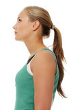 Side view of happy attractive female looking up Royalty Free Stock Image