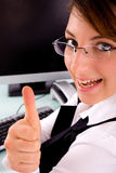Side view of happy businesswoman showing thumbs up Stock Images
