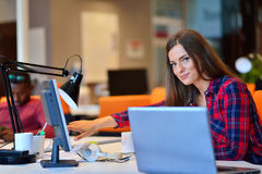 Side view of Happy businesswoman working on her laptop in the office Stock Photo