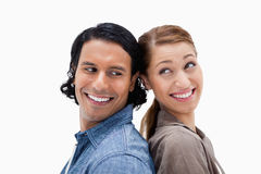 Side view of happy couple standing back to back Royalty Free Stock Image