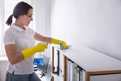 Janitor Cleaning Shelf With Rag royalty free stock images