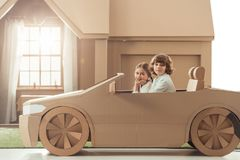 side view of happy little kids riding royalty free stock image