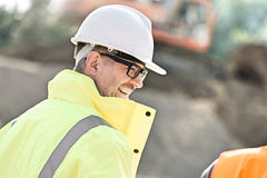 Side view of happy male supervisor at construction site Stock Photo