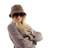 Side view of happy model in hat and overcoat Royalty Free Stock Photo