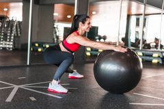 Cheerful adult woman training with medicine ball royalty free stock photography