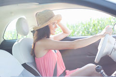 Side view of happy woman driving car Stock Photography