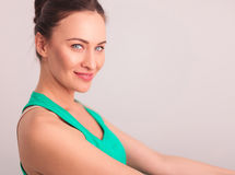 Side view of a happy woman in green undershirt Stock Image