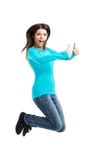 Side view happy woman jumping with thumbs up Stock Image