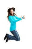 Side view happy woman jumping with thumbs up Royalty Free Stock Photography