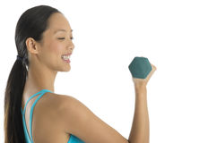 Side View Of Happy Woman Lifting Dumbbells Stock Photos