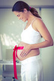 Side view of happy woman with red ribbon Stock Photos
