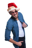 Side view of a happy young man in santa hat Stock Photography