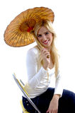 Side view of happy young woman holding umbrella Stock Images