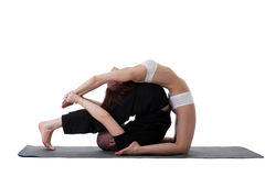 Side view of healthy couple doing yoga in studio Stock Photography