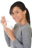 Side view healthy woman eating yoghurt Royalty Free Stock Image