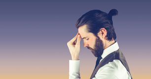 Side view of hippie businessman suffering from headache Royalty Free Stock Photo