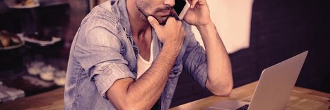 Side view of hipster man working stock photos