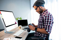 Side view of hipster working at desk Royalty Free Stock Photography