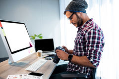 Side view of hipster working at desk Stock Photography