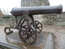 Historic cannon in Rochester, Kent. Side view of a historic cannon outside the castle in Rochester, Kent Royalty Free Stock Images