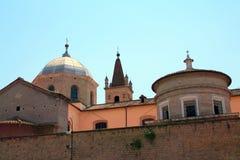 Historic church dome and spire, Tivoli, Italy. Side view of an historical church, with dome and spires, Tivoli, Lazio, Italy Royalty Free Stock Photos