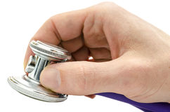 Holding a stethoscope over white background Royalty Free Stock Photos