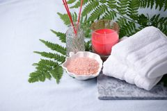Side view of home wellness spa products, aroma bath salt, aroma stick, cotton towels. Relax mindfulness style zen set, minimal. Background royalty free stock photos