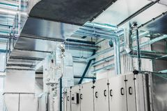 Air handling unit, industrial ventilation, air conditioner, commercial, insulation, pipeline. Side view of the huge industrial air handling unit in the stock photo