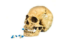 Side view of human skull with pill in teeth Stock Photo